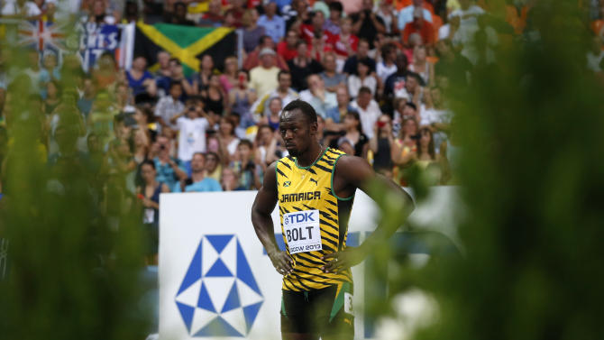 Jamaica's Usain Bolt prepares to competes in the men's 100-meter heat at the World Athletics Championships in the Luzhniki stadium in Moscow, Russia, Saturday, Aug. 10, 2013. (AP Photo/Matt Dunham)