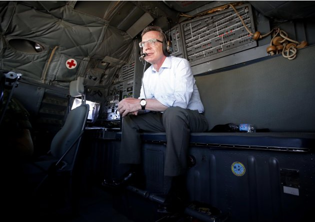 German Defence Minister de Maiziere sits in the cockpit of a Transall German Airforce aircraft en route from Mazar-e-Sharif to Herat