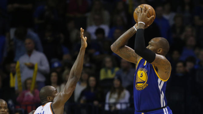 Golden State Warriors forward Marreese Speights (5) shoots in front of Oklahoma City Thunder forward Serge Ibaka (9) in the third quarter of an NBA basketball game in Oklahoma City, Sunday, Nov. 23, 2014. (AP Photo/Sue Ogrocki)