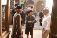 "In this image released by Paramount Pictures, actors Emily Mortimer, left, and Asa Butterfield listen to director Martin Scorsese on the set of ""Hugo."" The film, adapted from Brian Selznick's award-winning illustrated book ""The Invention of Hugo Cabret,"" is about a 12-year-old orphan who lives in a 1930 Paris train station. (AP Photo/Paramount Pictures, Jaap Buitendijk)"
