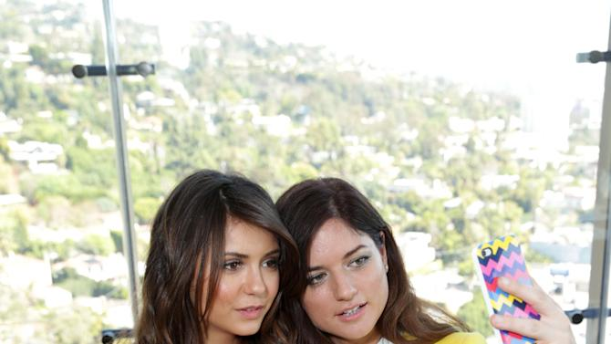 Nina Dobrev and Ilaria Urbinati at The Hollywood Reporter and Jimmy Choo Celebration of the Most Powerful Stylists in Hollywood, on Wednesday, March, 13, 2013 in Los Angeles. (Photo by Eric Charbonneau/Invision for The Hollywood Reporter/AP Images)