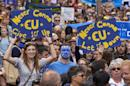 People hold up pro-Europe signs as thousands of protesters take part in a march through the centre of London on July 2, 2016