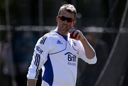 England cricket team player Swann reacts as he watches team mates during a training session at the University Oval in Dunedin