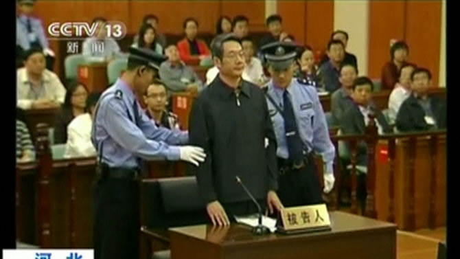 Still image taken from video shows former deputy head of China's top planning agency Liu arriving for his trial at Intermediate People's Court in Langfang, Hebei province