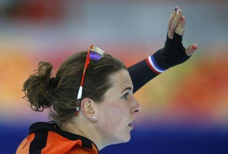 Irene Wust of the Netherlands waves after the women's 1,000 metres speed skating race at the Adler Arena during the 2014 Sochi Winter Olympics