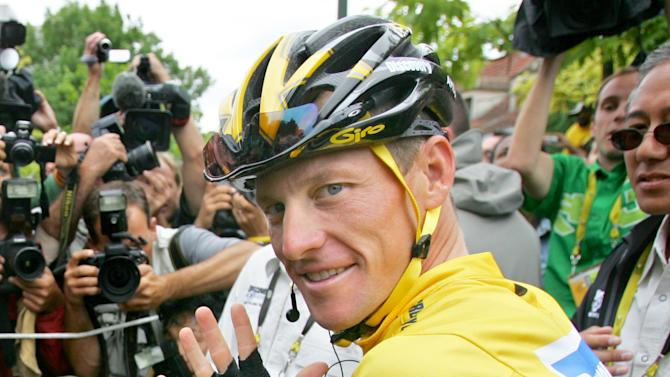 FILE - In this July 24, 2005 file photo, Lance Armstrong wears a Nike logo on his jersey prior to the start of the 21st and final stage of the Tour de france cycling race, between Corbeil-Essonnes, south of Paris, and the French capital. Armstrong stepped down as chairman of his Livestrong cancer-fighting charity and Nike severed ties with him as fallout from the doping scandal swirling around the famed cyclist escalated Wednesday, Oct. 17, 2012.  (AP Photo/Peter Dejong, File)