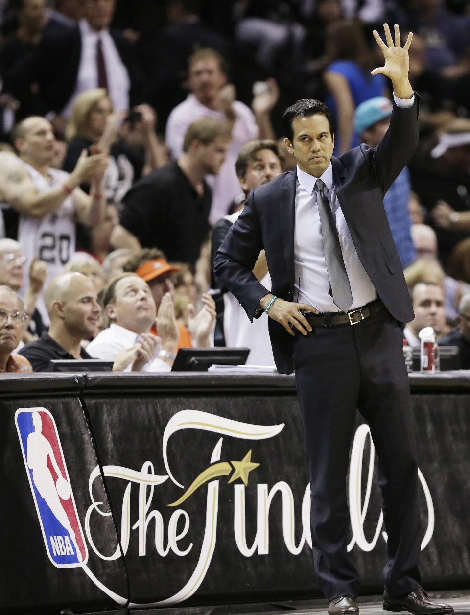 Miami Heat head coach Erik Spoelstra signals against the San Antonio Spurs during the first half at Game 5 of the NBA Finals basketball series, Sunday, June 16, 2013, in San Antonio. (AP Photo/Eric Gay)