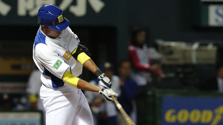 Brazil's third baseman Leonardo Reginatto hits an RBI single off Japan's starter Masahiro Tanaka in the first inning of their World Baseball Classic first round game at Yahoo Dome in Fukuoka, Japan, Saturday, March 2, 2013. (AP Photo/Koji Sasahara)