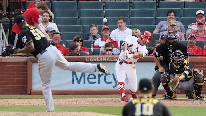 St. Louis Cardinals' Kolten Wong hits a walk-off solo home run off of Pittsburgh Pirates pitcher Radhames Liz in the 14th inning during a game between the  Cardinals and the  Pirates on Sunday, May 3, 2015, at Busch Stadium in St. Louis.   (Chris Lee/St. Louis Post-Dispatch via AP)  EDWARDSVILLE INTELLIGENCER OUT; THE ALTON TELEGRAPH OUT; MANDATORY CREDIT