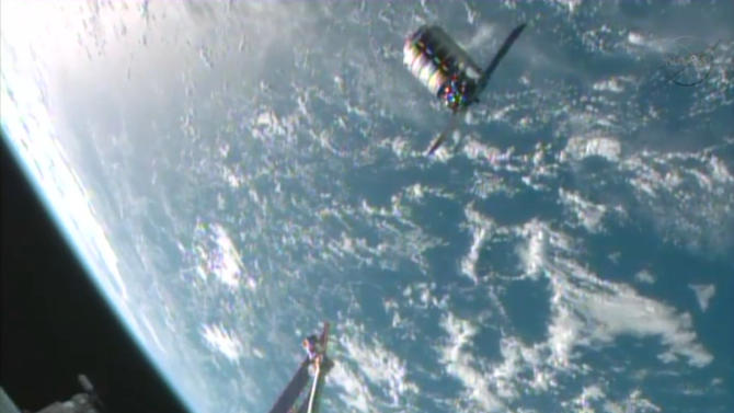 This framegrabbed image provided by NASA-TV shows the Cygnus spacecraft at the 30 meter hold point from the International Space Station Sunday Sept. 29, 2013 as both cross over the Atlantic Ocean. (AP Photo/NASA-TV)