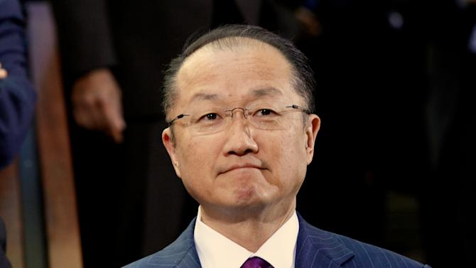 World Bank President Jim Yong Kim arrives for the International Monetary Fund Governors family photo during  the World Bank IMF Spring Meetings in Washington Saturday, April 20, 2013. (AP Photo/Molly Riley)