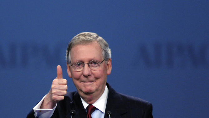 Senate Minority Leader Mitch McConnell, R-Ky., gives a thumbs-up as he finishes his address to the American Israel Public Affairs Committee (AIPAC) Policy Conference opening plenary session in Washington, Monday, March 5, 2012. (AP Photo/Cliff Owen)