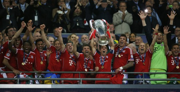 Bayern Munich's players celebrate with the trophy after defeating Borussia Dortmund in their Champions League Final soccer match at Wembley Stadium in London