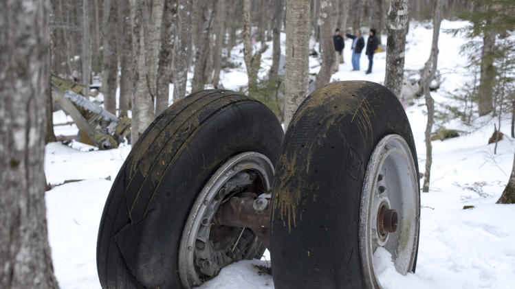 This photo made Friday, Dec. 14, 2012, shows a set of wheels from a B-52 bomber that crashed into Elephant Mountain near Greenville, Maine, on Jan. 24, 1963. Seven of the nine people on board died in the crash. Much of the plane's wreckage remains on the mountain. (AP Photo/Robert F. Bukaty)