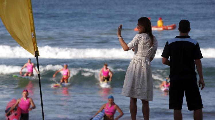 Catherine, Britain's Duchess of Cambridge, waves as she watches junior surf lifesavers during a visit to Sydney's Manly beach