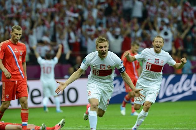 Polish Midfielder Jakub Blaszczykowski (C) Celebrates AFP/Getty Images