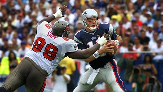 FILE - In this Sept. 3, 2000 file photo, Tampa Bay Buccaneers defensive tackle Warren Sapp (99) reaches up and sacks New England Patriots quarterback Drew Bledsoe, right, during the first quarter of an NFL football game in Foxborough, Mass. Sapp is a finalist for the Pro Football Hall of Fame,  the hall announced Friday, Jan. 11, 2013.  (AP Photo/Charles Krupa, File)