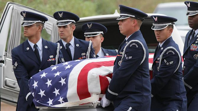 """CORRECTS DATE - Air Force servicemen carry the casket of actor Sherman Hemsley who was buried at the Fort Bliss National Cemetery with military honors, Wednesday, Nov. 21, 2012 in Fort Bliss, Texas. Friends and family remembered Hemsley at his funeral service in Texas by showing video clips of his best known role as George Jefferson on the TV sitcom """"The Jeffersons."""" He died in July but a fight over his estate has delayed his burial. (AP Photo/The El Paso Times, Mark Lambie)  EL DIARIO OUT; JUAREZ MEXICO OUT AND EL DIARIO DE EL PASO OUT"""
