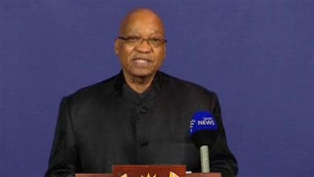Still image taken from video shows South African President Jacob Zuma speaking on the passing of former South African President Nelson Mandela