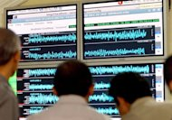 Indonesian meteorological officials check a seismograph screen as they test a tsunami early warning system in Jakarta, on December 26, 2005. A strong 6.1-magnitude earthquake has struck off the coast of central Indonesia, the US Geological Survey said, sending panicked people rushing into the streets but there was no tsunami alert