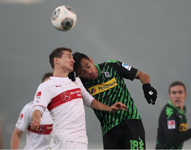 Stuttgart's Daniel Schwaab, left, and Moenchengladbach's Juan Arango challenge for the ball during the German first division Bundesliga soccer match between VfB Stuttgart and Borussia Moenchengladbach
