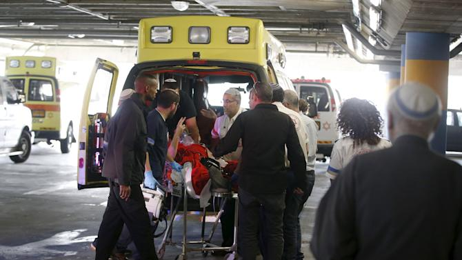 A wounded Israeli man is evacuated to a hospital in Jerusalem