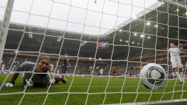 United States goalkeeper Hope Solo looks at the ball in the net after France scored their first goal during the semifinal match between France and the United States at the Women's Soccer World Cup in Moenchengladbach, Germany, Wednesday, July 13, 2011. (AP Photo/Frank Augstein)
