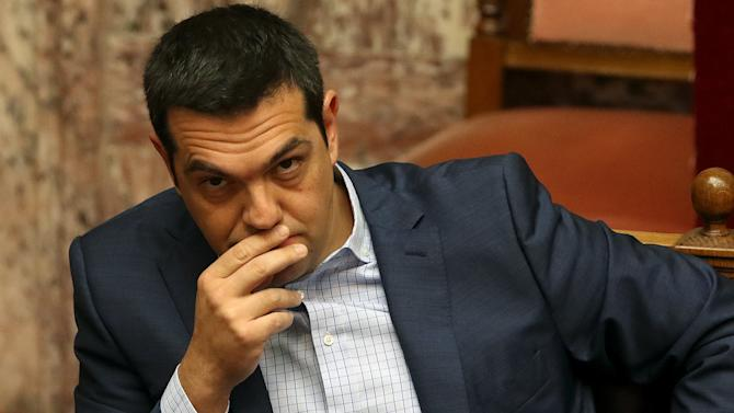 Greek Prime Minister Alexis Tsipras looks on during the Prime Minister's Questions at parliament in Athens