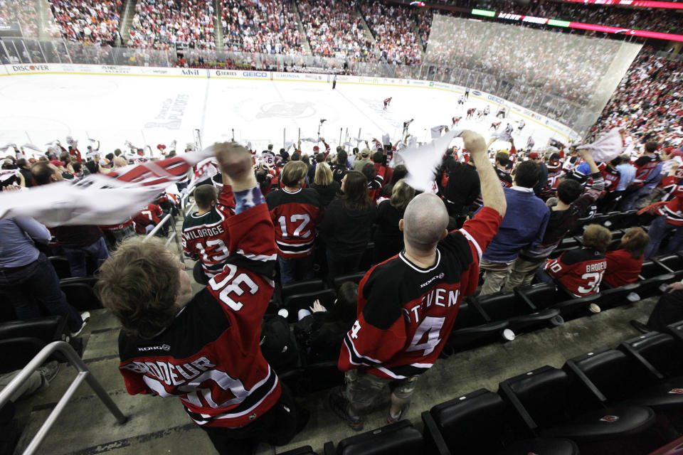 Spectators wave towels during the third period of Game 4 of a second-round NHL hockey Stanley Cup playoff series between the New Jersey Devils and the Philadelphia Flyers, Sunday, May 6, 2012 in Newark, N.J. The Devils won 4-2 and take a 3-1 lead in the series. (AP Photo/Julio Cortez)