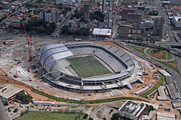 This Sept. 2013 photo released by Portal da Copa shows an aerial view of the Arena das Dunas stadium in Natal, Rio Grande do Norte state, Brazil. With less than three months to go before the December