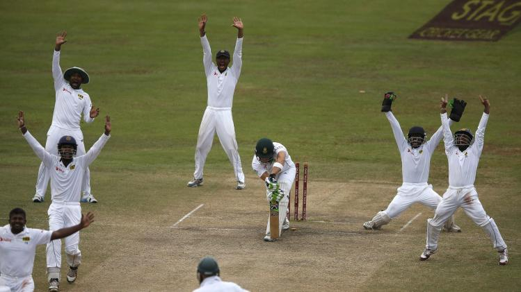 Sri Lanka's cricket team members appeal for an unsuccessful wicket of South Africa's du Plessis during the fifth and final day of their second test cricket match in Colombo