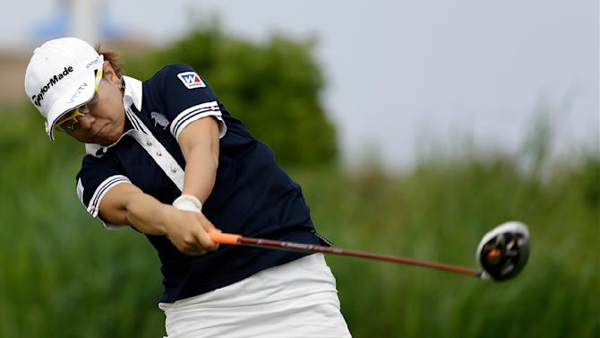 Mika Miyazato, of Japan, hits a tee shot on the 16th hole during the second round of the U.S. Women's Open golf tournament at the Sebonack Golf Club Friday, June 28, 2013, in Southampton, N.Y. (AP Photo/Frank Franklin II)