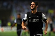 Malaga&#39;s Isco celebrates after scoring during their Champions League match against Zenit St. Petersburg on September 18. Malaga, although not playing at their best, held on for a 0-0 draw last weekend against an Athletic Bilbao side