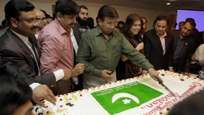 Former Pakistani President Pervez Musharraf, center, cuts a cake during a ceremony to celebrate Pakistan National Day ahead od his trip to Karachi, in Dubai, United Arab Emirates, Saturday, March 23, 2013. Musharraf says he will follow through with his plans to return to his homeland despite risks of arrest and other threats. (AP Photo/Kamran Jebreili)
