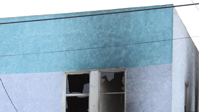 Fire roared through the Palos Verdes Inn, a 90-year-old residential hotel in the harbor area, early Tuesday, Jan. 22, 2013, injuring 14 people, three of them critically, in San Pedro, Calif. People hung out of windows of the Palos Verdes Inn  after the fire broke out at about 3:30 a.m., and one woman jumped from a second-story window and may have broken bones, Fire Department spokesman Erik Scott said. (AP Photo/The Daily Breeze, Chuck Bennett)  MAGS OUT; NO SALES