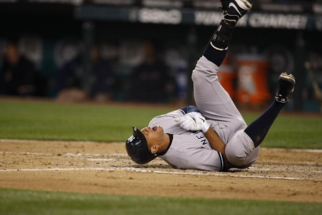 New York Yankees' Alex Rodriguez rolls on the ground after being hit by a pitch in the eighth inning of a baseball game against the Seattle Mariners, Tuesday, July 24, 2012, in Seattle. (AP Photo/Kevin P. Casey)