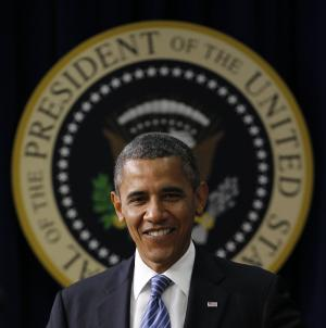 President Barack Obama walks towards the podium to talk about taxes, Friday, Aug. 3, 2012, in the Old Executive Office building of the White House complex in Washington. (AP Photo/Pablo Martinez Monsivais)