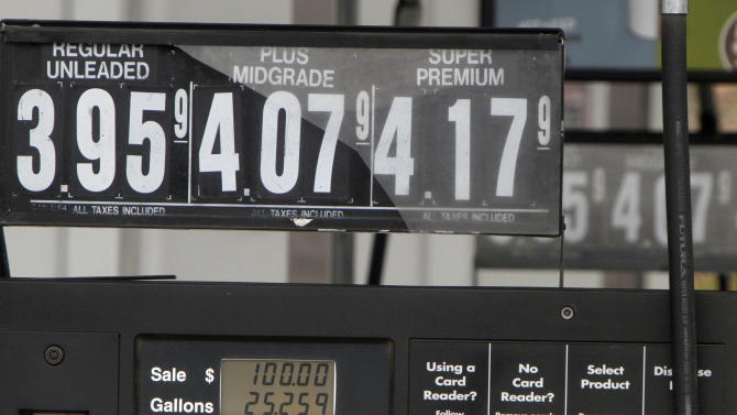 FILE - This April 20, 2012, file photo, shows a gas pump displaying a $100 sale in Barre Vt. The government said Tuesday, May 8, 2012, that gasoline will be cheaper this summer than previously expected thanks to a drop in the price of oil. The Energy Department says drivers should pay an average of $3.79 per gallon at the pump from April through September. (AP Photo/Toby Talbot, File)