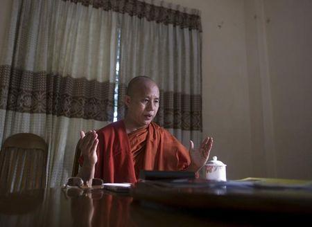 Myanmar's firebrand Buddhist monk Wirathu talks in a supporter's home during a Reuters interview in Yangon