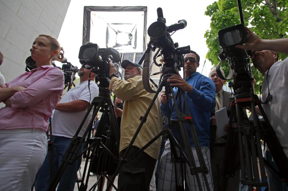 Members of the media wait for Elizabeth Smart to exit the Frank E. Moss Federal Courthouse, Wednesday, May 25, 2011, in Salt Lake City. Smart's kidnapper, Brian David Mitchell, was sentenced to life in prison. (AP Photo/Jim Urquhart)