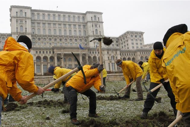 Greenpeace activists dig into the yard of Romania's Parliament in Bucharest