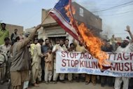 Activists of Pakistan Muthidda Shehri Mahaz burn the US flag during a protest in Multan in March against US drone attacks. US missiles have killed four militants in a Taliban stronghold of Pakistan, officials said, amid increasing strains with the West over a six-month blockade on NATO supplies into Afghanistan