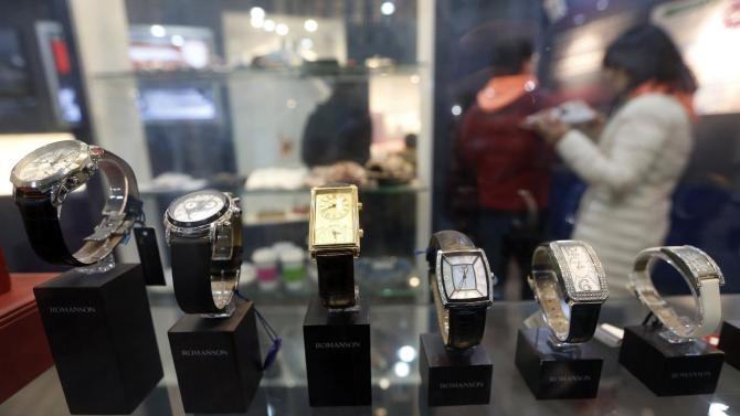 Visitors walks around near the products which were made at Kaesong Industrial Complex in North Korea at its showroom at the unification observatory in Paju, South Korea, Wednesday, Feb. 10, 2016. South Korea says Wednesday it will halt operations at joint industrial park with North Korea in response to the North's recent rocket launch. (AP Photo/Lee Jin-man)