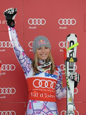 Lindsey Vonn, of the United States, celebrates on the podium after winning an alpine ski World Cup women's downhill race, in Val d'Isere, France, Saturday, Dec. 18, 2010. (AP Photo/Giovanni Auletta)