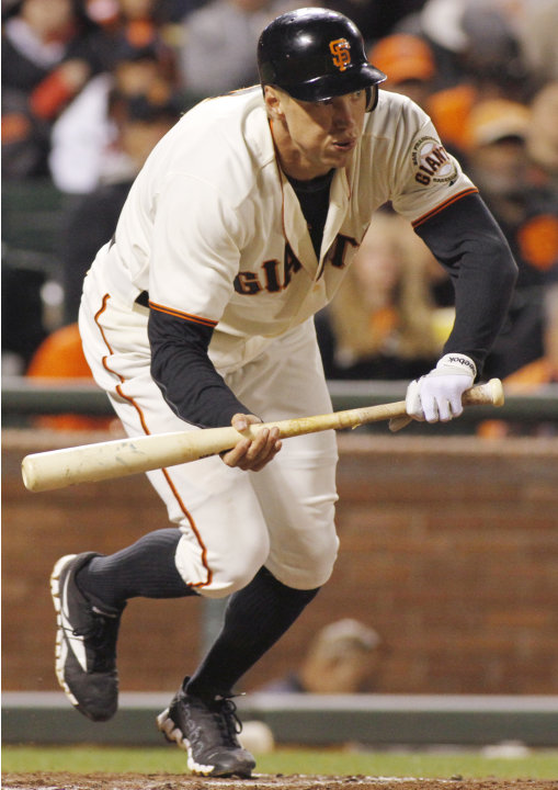 San Francisco Giants' Hunter Pence bunts for an RBI single against the Atlanta Braves during the fifth inning of a baseball game in San Francisco, Thursday, Aug. 23, 2012. (AP Photo/George Nikitin)