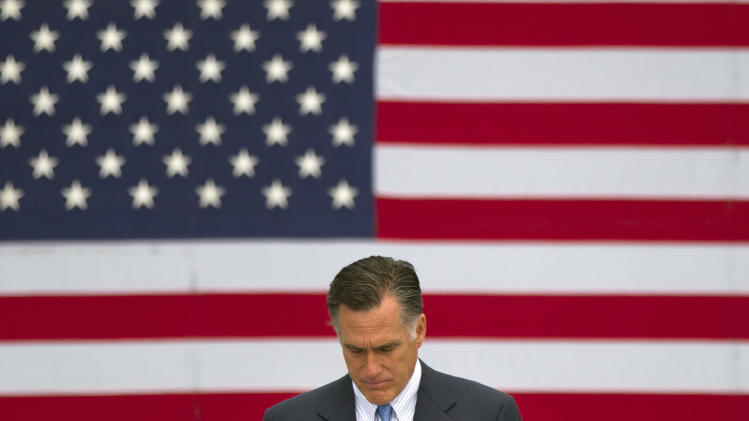 Republican presidential candidate, former Massachusetts Gov. Mitt Romney speaks about the shootings in Colorado at an event in Bow, N.H., Friday, July 20, 2012.  (AP Photo/Evan Vucci)