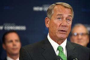 Boehner speaks to reporters at a news conference following …
