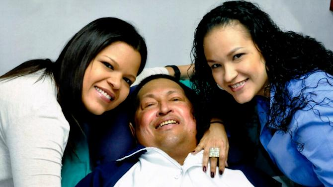 In this photo released Friday, Feb. 15, 2013 by Miraflores Presidential Press Office, Venezuela's President Hugo Chavez, center, poses for a photo with his daughters, Maria Gabriela, left, and Rosa Virginia at an unknown location in Havana, Cuba, Thursday, Feb. 14, 2013. Chavez remains in Havana undergoing unspecified treatments following his fourth cancer-related operation on Dec. 11. He has hasn't been seen or spoken publicly in more than two months. (AP Photo/Miraflores Presidential Press Office)