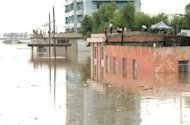 Fooded houses in Anju city in South Phongan province. The flooding represents a challenge for Kim Jong-Un, new leader of the nation which has grappled with severe food shortages since a famine in the 1990s killed hundreds of thousands