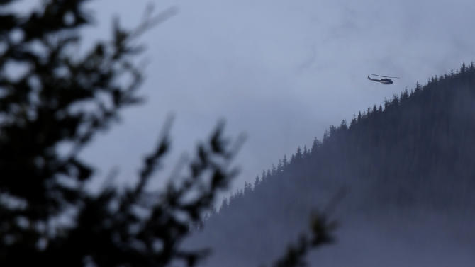A King Co. Sheriff's Dept. helicopter flies over rugged terrain, Friday, Jan. 4, 2013, near Mount Si in North Bend, Wash. Searchers in the air and on the ground were looking for 29-year-old Kurt Ruppert, who has been missing since a skydiving trip on Thursday. (AP Photo/Ted S. Warren)